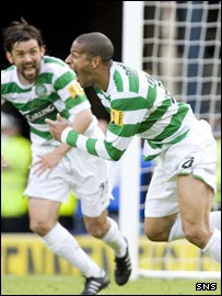 Perrier Doumbe celebrates his winner with Paul Hartley