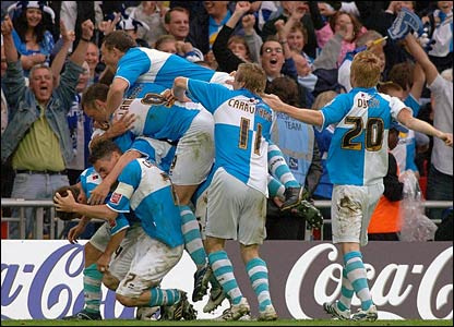 The Bristol Rovers fans and players celebrate Sammy Igoe's late goal
