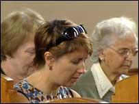 Woman praying in Belfast church