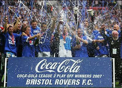 Bristol Rovers celebrate in front of the ecstatic fans