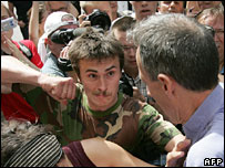 Nationalist about to punch gay rights activists Peter Tatchell