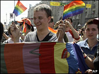 Gay rights activists waving rainbow flags