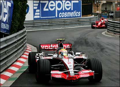 Lewis Hamilton in fron of Ferrari's Felipe Massa