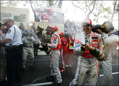 Fernando Alonso and Lewis Hamilton spray champagne