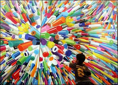 A child looks at a painting by South Korean artist Hong Kyong-tack entitled Pencil One