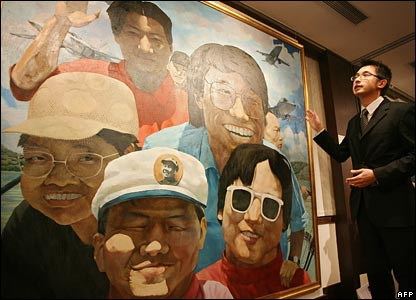 Christie's Dick Lee next to Portrait of the Artist and His Friends by Yue Minjun