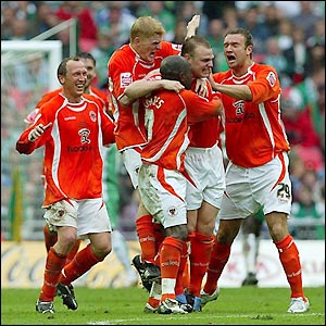 Blackpool's players celebrate their opening goal