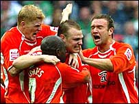 Blackpool celebrate Robbie Williams' opening goal
