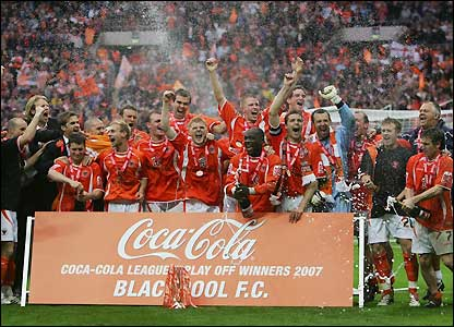 Blackpool's players celebrate promotion
