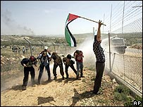 Unarmed international, Israeli and Palestinian activists protest against West Bank barrier