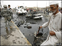 Man walks past bomb damage near Abdul Qadir Gilani mosque, 28 May 2007