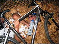 Man asleep under bike