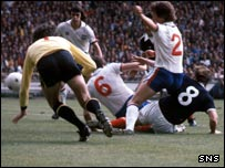 Kenny Dalglish slides the ball past Ray Clemence to make it 2-0
