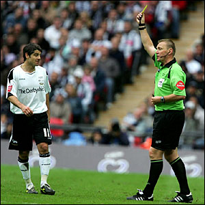 Paul Peschisolido is booked by referee Graham Poll