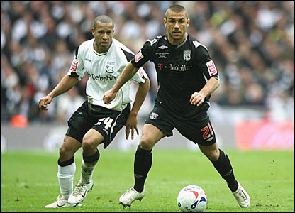 Derby's Tyrone Mears challenges Kevin Phillips for the ball