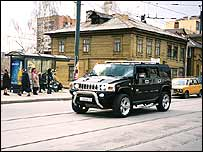 Hummer driving down a street in Russia