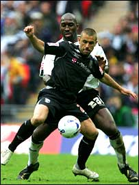 Derby defender Darren Moore marshals West Brom striker Kevin Phillips