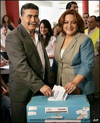 Labour leader Amir Peretz (left) votes with his wife
