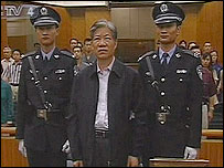 Grab from TV footage of Zheng Xiaoyu in court