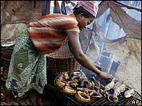 Woman smoking fish in Lagos