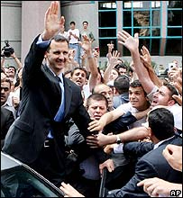 President Assad's supporters greet him
