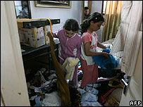 Children inspect room overturned by Israeli soldiers