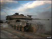 Israeli tank rolling into Gaza Strip
