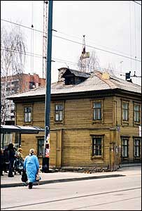 Old woman walks down rural Russian street