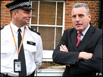 Home Office minister Vernon Coaker with police officer
