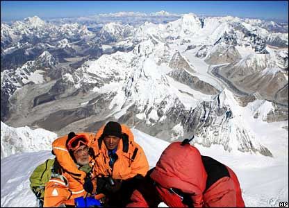 Japanese mountain climber Katsusuke Yanagisawa, left, 71 looks on atop the summit of Mount Everest (photo supplied provided by Japanese mountain guide Hiroyuki Kuraoka)