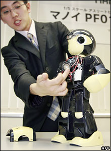 Japan's radio-controlled model-maker Kyosho displays a humanoid robot called Manoi PF01