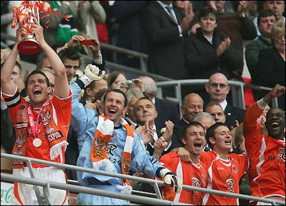 Michael Jackson of Blackpool lifts the play-off trophy