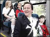 David Cameron on a school bus