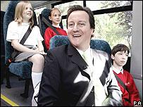 David Cameron on a school bus