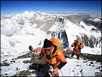 Katsusuke Yanagisawa, foreground, climbs towards the summit of Mount Everest