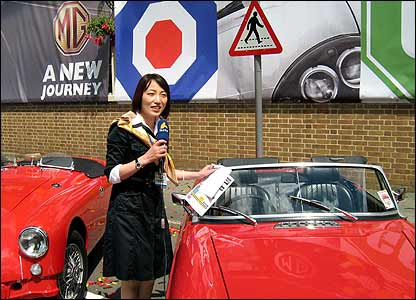 Chinese woman journalist reporting from Longbridge
