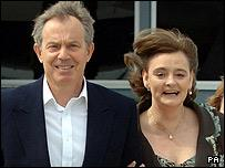 British Prime Minister Tony Blair and his wife Cherie depart on their African tour