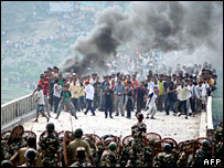 Bhutanese refugees living in Nepal try to enter the Indian state of West Bengal on May 29 2007