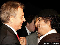 Tony Blair hugging Colonel Gaddafi