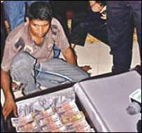 Bangladeshi police with the cash horde
