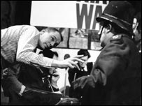 Sherrin directing a sketch involving a policeman on TW3