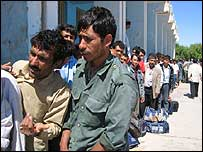 Men arriving in Afghanistan over the Islam Qala border