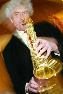 Rhodri Morgan trying the saxophone (pictured in 2004)