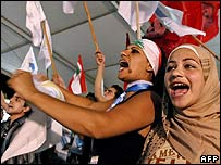 Lebanese government supporters cheer after the UN vote