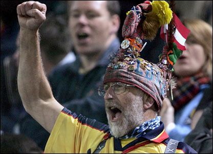 A Scotland fan celebrates the victory in Austra