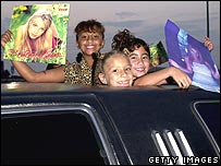 Young Britney Spears fans arrive at a concert 