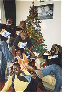 Teenagers around Marsali's Christmas tree