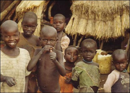 Children outside huts in Karamoja