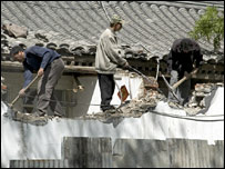 File image of workers demolishing a traditional house in Beijing