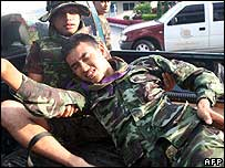 Wounded soldier is helped following a bomb blast in Thailand. 31/05/2007